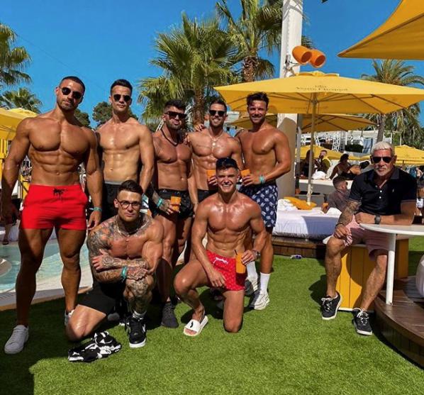 Wayne Lineker with topless men