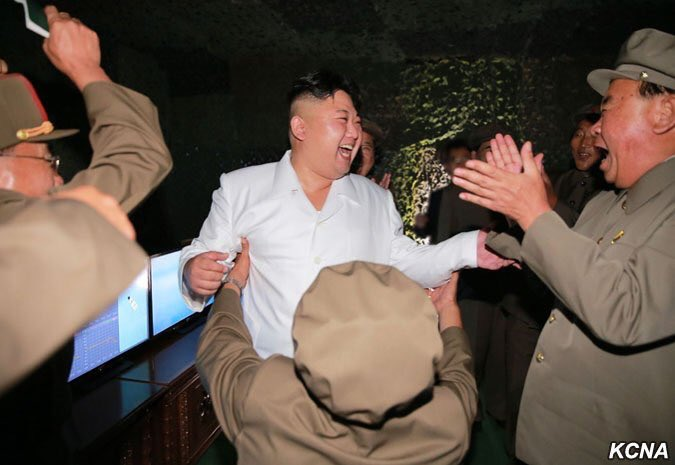Kim Yong Un celebrating with army goons