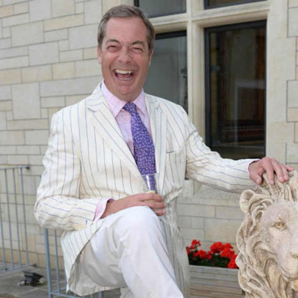 Nigel Farage being a cock in a white suit