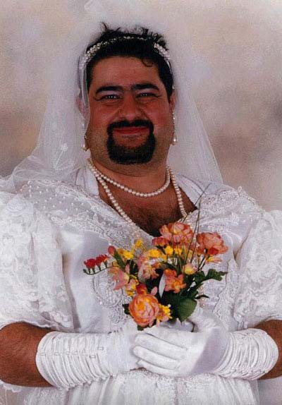 Fat bloke in a wedding dress and make-up, kind of 80's vibe